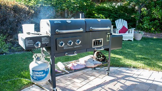 propane gas grill set up on a backyard