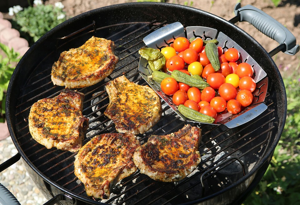 grilling a porkchop and cherry tomatoes